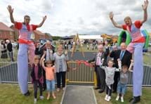 Stiltwalkers, residents and dignitaries at the Centurion Park community day