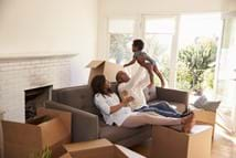 Parents Take A Break On Sofa With Son On Moving Day shutterstock_539142574.jpg